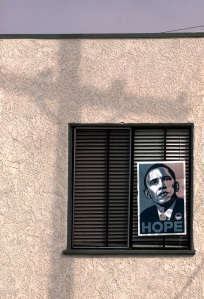 A poster of Presidential Candidate Barack Obam is displayed in the second floor window of an apartment on Balboa Penninsula in Newport Beach.