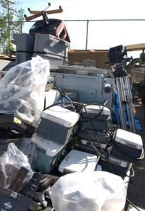 Surplus goods are piled around Saddleback College's warehouse in the village on Wednesday in preparation for auction on November 1st.